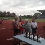 Ellie receiving 6th place trophy